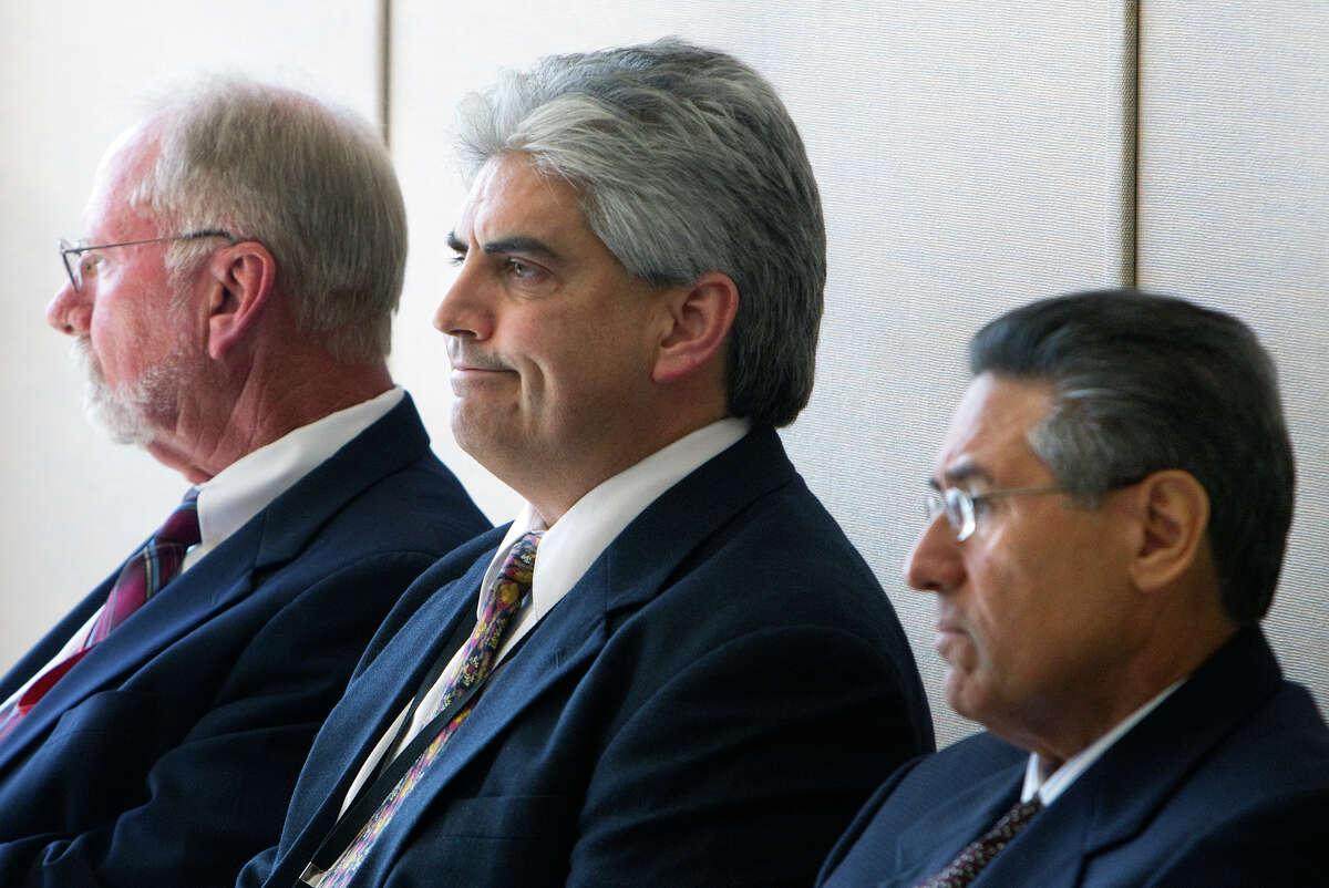 Paul Becker, left, who resigned as director of the Harris County Probation Department, was questioned this week, along with deputy directors Ray Garcia, center, and Gilbert Garcia, about mishandling of drug tests at the agency. The investigation was launched by defense attorney Lisa Andrews.