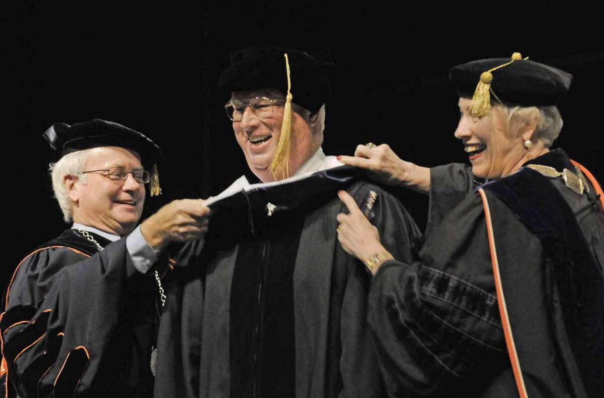 Businessman and philanthropist Richard Liebich, center, was given an honorary degree by Empire State College president Alan R. Davis, left, and SUNY Chancellor Nancy L. Zimpher, right, during the Empire State College commencement June, 12, 2010, at the EGG in Albany, N.Y. (Michael P. Farrell / Times Union archive)