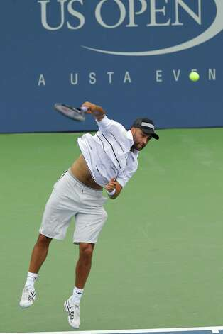 James Blake  serves to Lukas Lacko, of Slovakia, at the 2012 US Open Tennis tournament, Monday, Aug. 27, 2012, in New York. (AP Photo/Kathy Willens) Photo: Kathy Willens, Associated Press / AP