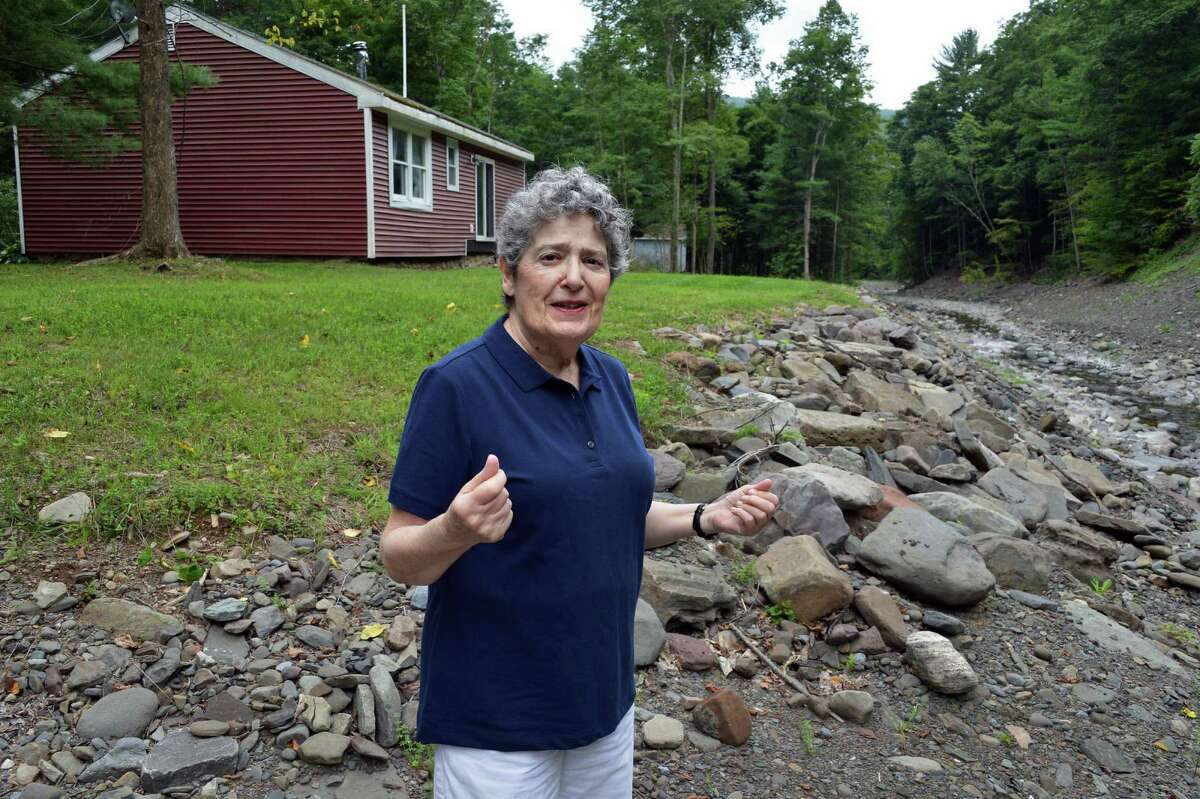 Constance Rauch at her little red house along the banks of Lake Creek in Livingstonville, Schoharie County Friday Aug. 17, 2012. The house was spared by Irene's flooding last year and she has reclaimed the property with the help of neighbors but the area is still struggling to recover from the tropical storm. (John Carl D'Annibale / Times Union)