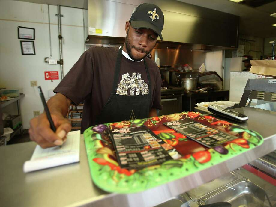 Harvey Yancy, 35, an employee of Lyriq's Cafe in west Houston, settled here following Hurricane Katrina and has made it his home. Photo: Karen Warren / © 2012  Houston Chronicle