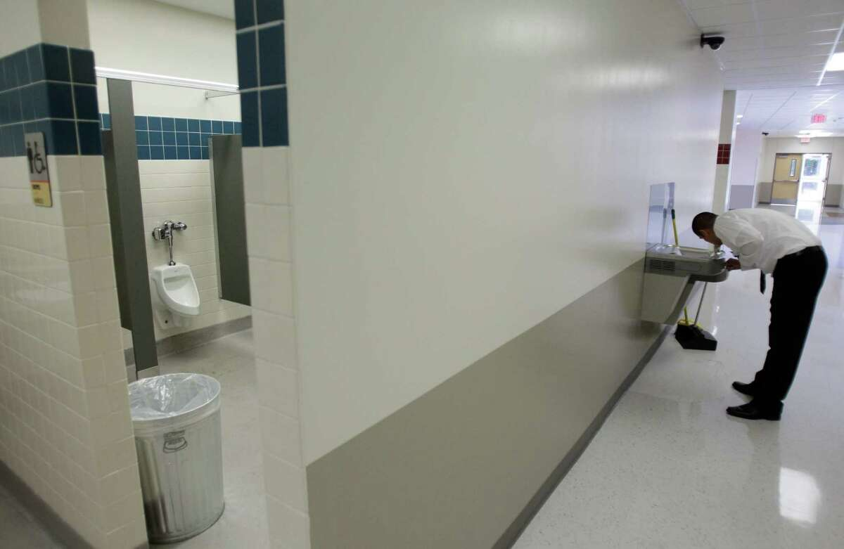 An open concept restroom provides too much of a view on the first day of school at the new Billy Reagan K-8 Education Center, 4842 Anderson Road, Monday, Aug. 27, 2012, in Houston. HISD Superintendent Terry Grier said that panels have been ordered to cover the doorway and will be delivered Monday night. ( Melissa Phillip / Houston Chronicle )