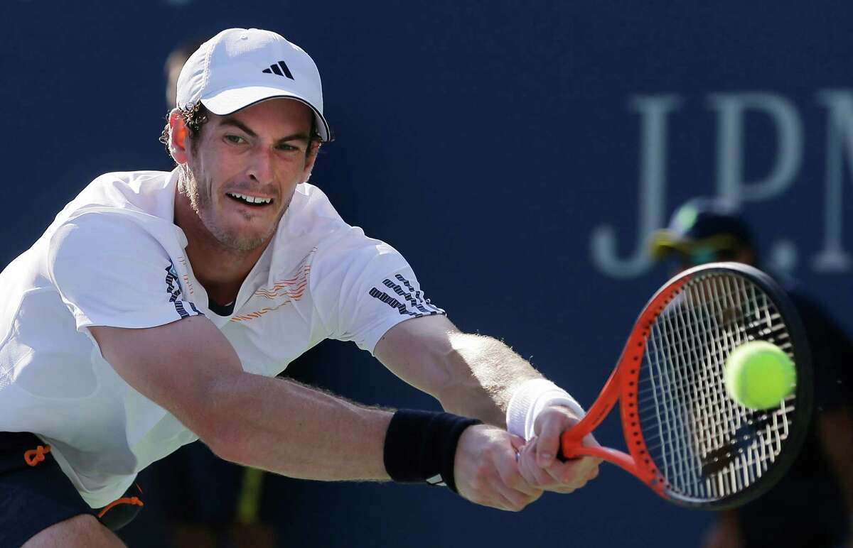 Britain's Andy Murray returns a shot to Alex Bogomolov Jr., of Russia, at the 2012 U.S. Open tennis tournament, Monday, Aug. 27, 2012, in New York. Murray won the match. (AP Photo/Mike Groll)