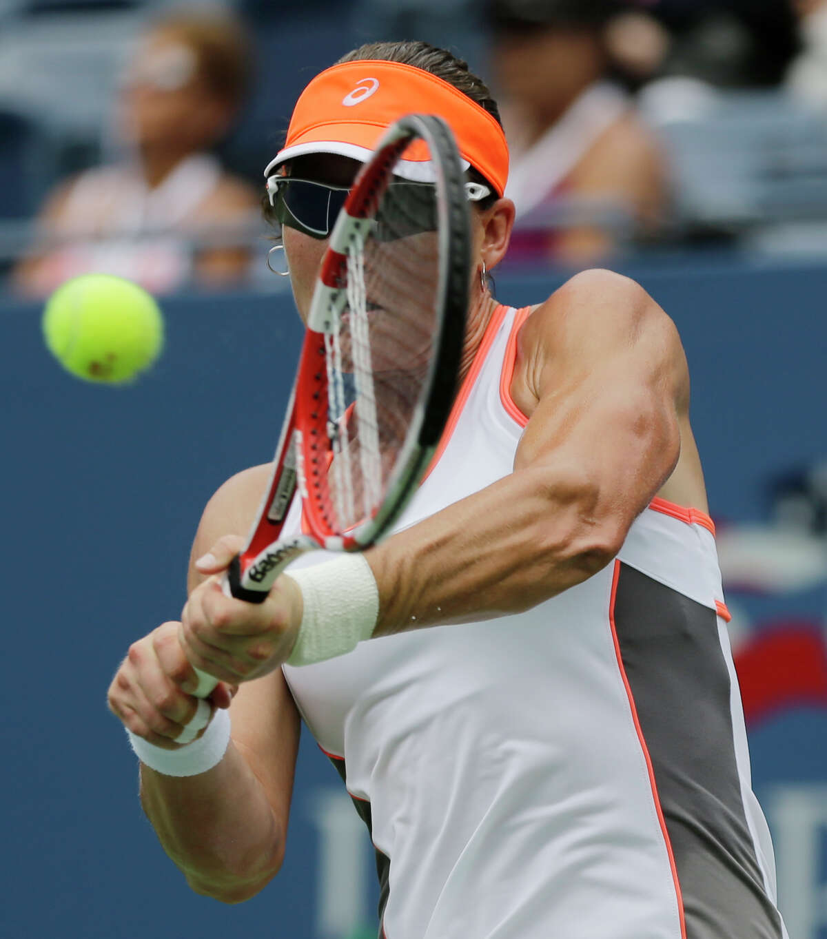 Samantha Stosur, of Australia, returns a shot to Petra Martic, of Croatia, at the 2012 US Open Tennis tournament, Monday, Aug. 27, 2012, in New York. (AP Photo/Mike Groll)