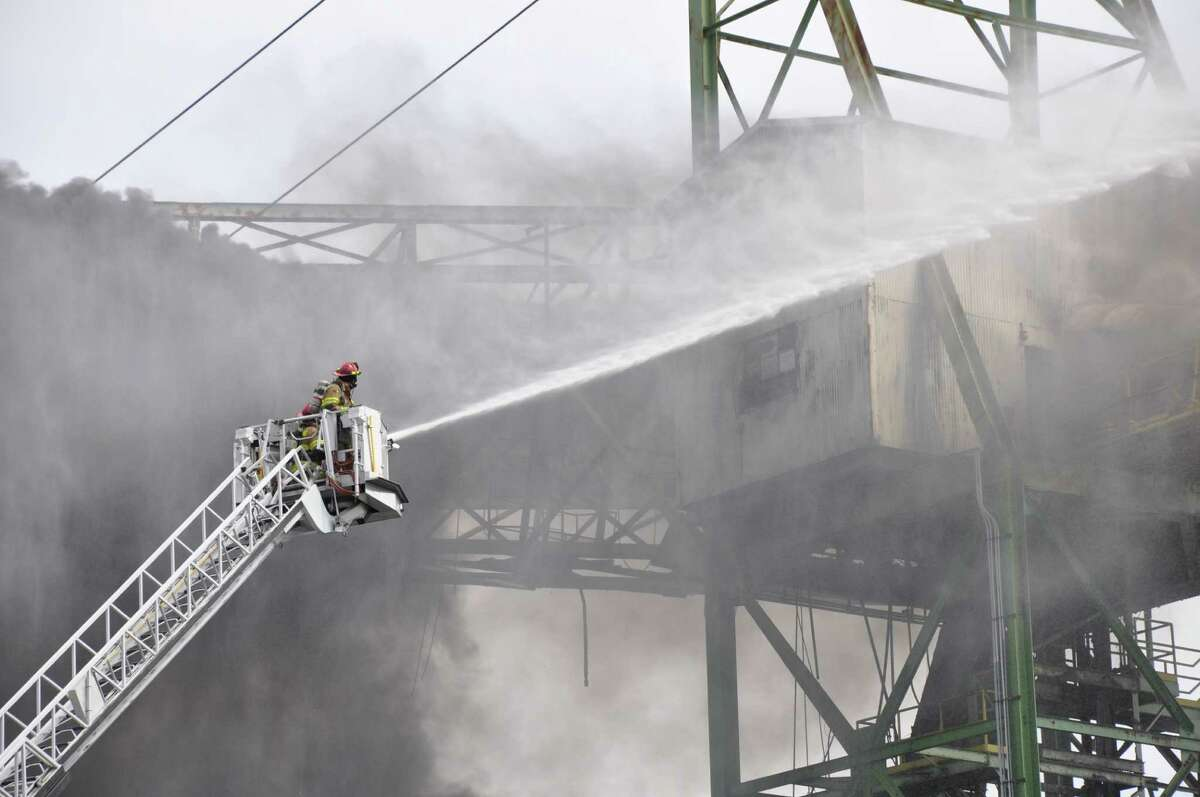 Firefighters douse a fire on a conveyor belt at the Lafarge cement plant in Ravena. Aug. 27, 2012 (Photo courtesy of Coeymans Police Department