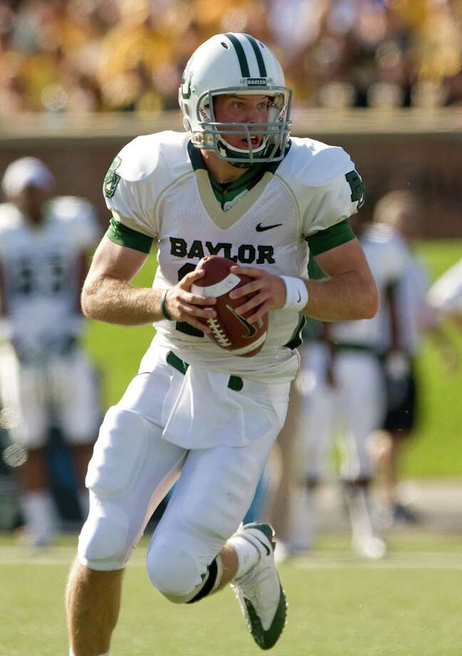 FILE - In this Nov. 7, 2009, file photo, Baylor quarterback Nick Florence tries to find an open receiver as he runs during the first quarter of an NCAA football game against Missouri in Columbia, Mo. The Baylor Bears are looking for Nick Florence to be more than a second-half fill-in for Heisman Trophy winner Robert Griffin III this season. (AP Photo/L.G. Patterson, File) Photo: L.G. Patterson / FR23535 AP