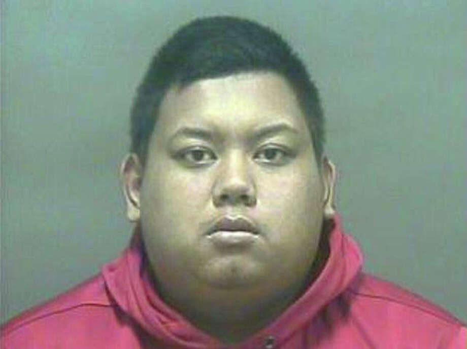 Chhinnarith Tuy, 22, was charged Monday, Aug. 27, 2012 for the second time in three days with impersonating a police officer in West Haven, Conn. Photo: Contributed Photo