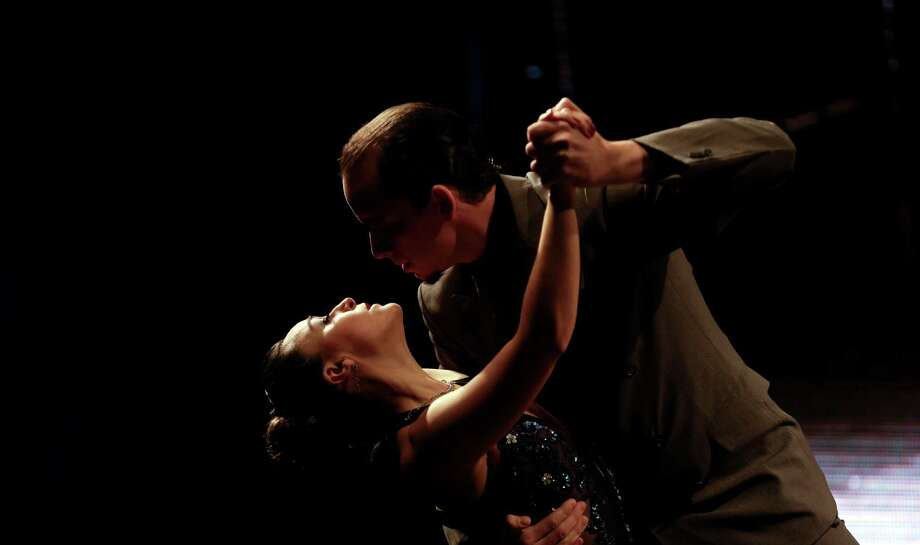 Colombian tango dance couple John Osorio and Diana Lopez compete in a stage category at the Tango Dance World Cup 2012 in Buenos Aires, Argentina, Wednesday, Aug. 22, 2012.  The two-week long event offers hundreds of free dance lessons, concerts and recitals, as professional dancers compete in the championship and teach many the eight basic steps of the dance in the city where it was born. Photo: Natacha Pisarenko, AP / AP