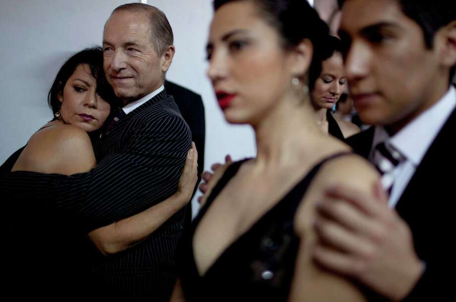 Italy's dancers Eloina Martins, left, and Paolo Nelzi, second from left, among others, wait before competing during the 2012 Tango Dance World Cup in Buenos Aires, Argentina, Monday, Aug. 20, 2012. The two-week long event offers more than 500 free dance lessons, concerts and recitals. Hundreds of professional dancers compete in the championship and teach many the eight basic steps of the dance in the city where it was born. Photo: Natacha Pisarenko, AP / AP