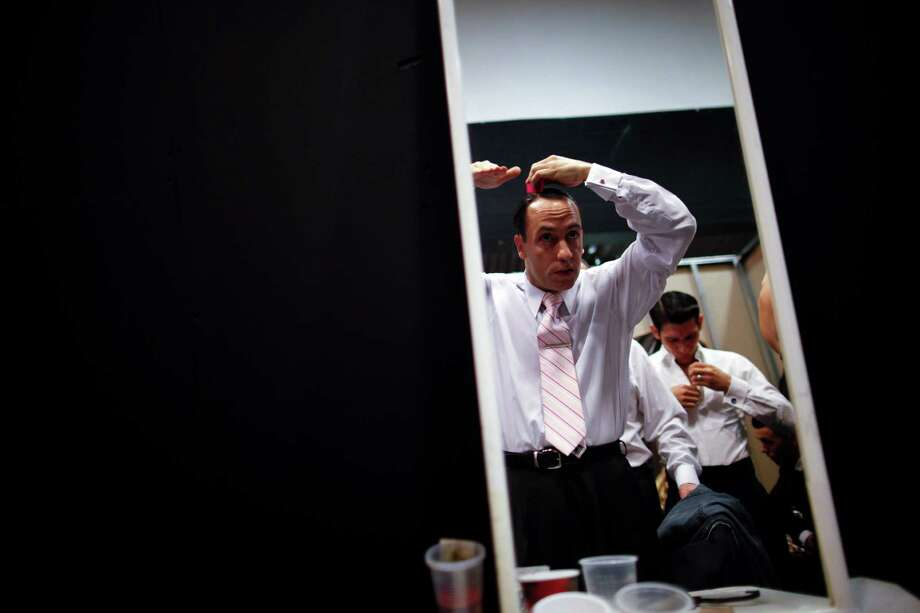 Argentina's dancer Cristian Lopez is seen reflected in a mirror as he combs his hair before competing in the 2012 Tango Dance World Cup salon finals in Buenos Aires, Argentina, Monday, Aug. 27, 2012. Couples from around the world competed in the finals Argentina's annual tango competition, the highlight of a two-week festival which this year honored Astor Piazzolla, the legendary composer and bandoneonista who revived the genre and infuriated purists by blending tango with rock music in the 1970s. Photo: Natacha Pisarenko, AP / AP