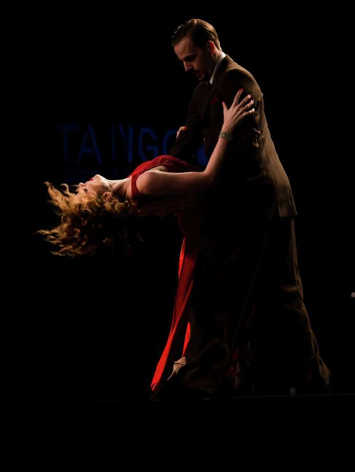 A tango couple competes in the stage category at the Tango Dance World Cup 2012 in Buenos Aires, Argentina, Wednesday, Aug. 22, 2012. The two-week long event offers free dance lessons, concerts and recitals, as professional dancers compete in the championship and teach many the eight basic steps of the dance in the city where it was born. Photo: Natacha Pisarenko, AP / AP