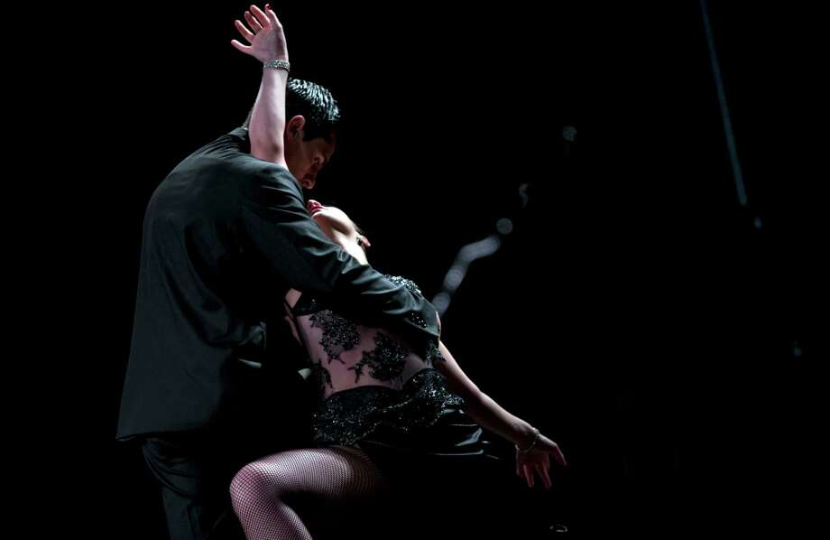 A tango dance couple compete in the stage category at the Tango Dance World Cup 2012 in Buenos Aires, Argentina, Wednesday, Aug. 22, 2012.  The two-week long event offers hundreds of free dance lessons, concerts and recitals, as professional dancers compete in the championship and teach many the eight basic steps of the dance in the city where it was born. Photo: Natacha Pisarenko, AP / AP