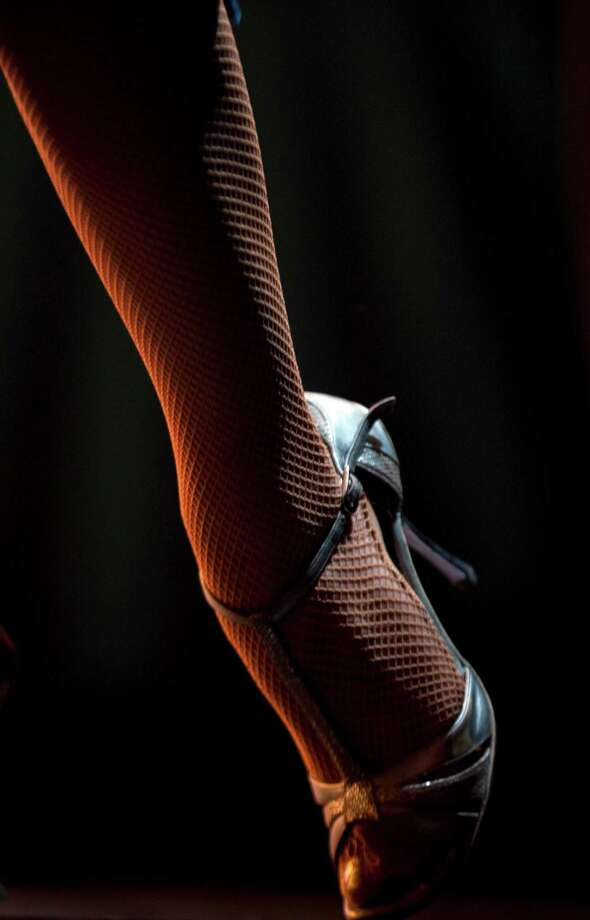 A dancer performs during the 2012 Tango Dance World Cup in Buenos Aires, Argentina, Monday, Aug. 20, 2012. The two-week long event offers more than 500 free dance lessons, concerts and recitals. Hundreds of professional dancers compete in the championship and teach many the eight basic steps of the dance in the city where it was born. Photo: Natacha Pisarenko, AP / AP