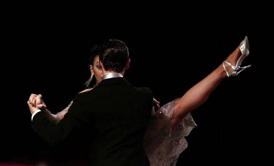 Argentine tango dance couple Guido Palacios and Florencia Castilla compete in the stage category at the Tango Dance World Cup 2012 in Buenos Aires, Argentina, Wednesday, Aug. 22, 2012.  The two-week long event offers hundreds of free dance lessons, concerts and recitals, as professional dancers compete in the championship and teach many the eight basic steps of the dance in the city where it was born. Photo: Natacha Pisarenko, AP / AP