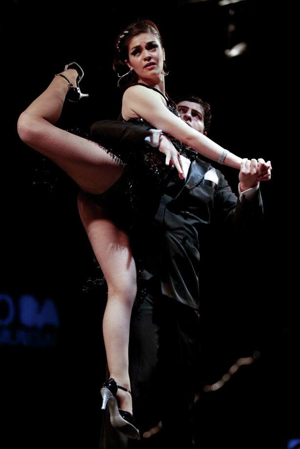 A tango dance couple compete in a stage category at the Tango Dance World Cup 2012 in Buenos Aires, Argentina, Wednesday, Aug. 22, 2012. The two-week long event offers hundreds of free dance lessons, concerts and recitals, as professional dancers compete in the championship and teach many the eight basic steps of the dance in the city where it was born. Photo: Natacha Pisarenko, AP / AP