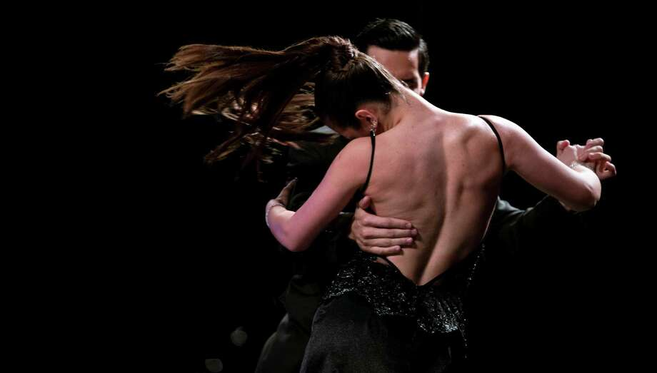 Argentine tango dance couple Jorge Carrizo and Valeria Romero compete in the stage category at the Tango Dance World Cup 2012 in Buenos Aires, Argentina, Wednesday, Aug. 22, 2012. The two-week long event offers hundreds of free dance lessons, concerts and recitals, as professional dancers compete in the championship and teach many the eight basic steps of the dance in the city where it was born. Photo: Natacha Pisarenko, AP / AP