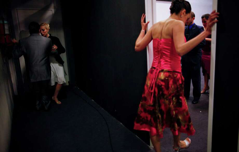 Dancers prepare backstage before competing in the 2012 Tango Dance World Cup salon finals in Buenos Aires, Argentina, Monday, Aug. 27, 2012. Argentina's annual tango competition, the highlight of a two-week festival which this year honored Astor Piazzolla, the legendary composer and bandoneonista who revived the genre and infuriated purists by blending tango with rock music in the 1970s. Photo: Natacha Pisarenko, AP / AP