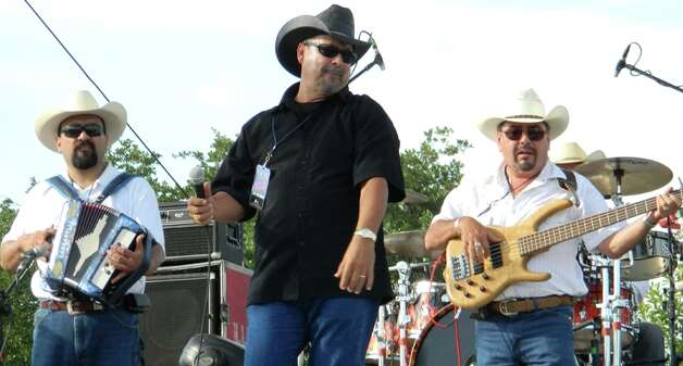 San Antonio Tejano band Maravia includes from left Jerry Fuentes, Joe Gutierrez and Greg Palacios. They're playing at the Tejano Fan Fair 2012 Photo: Courtesy Photo