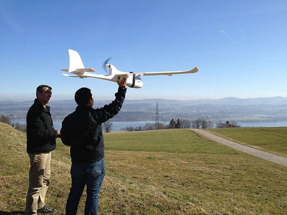 Lian Pin Koh (right) of the Swiss Federal Institute of Technology and partner Serge Wich conduct a drone test flight in Zurich. Photo: Juanita Choo-Koh, Associated Press