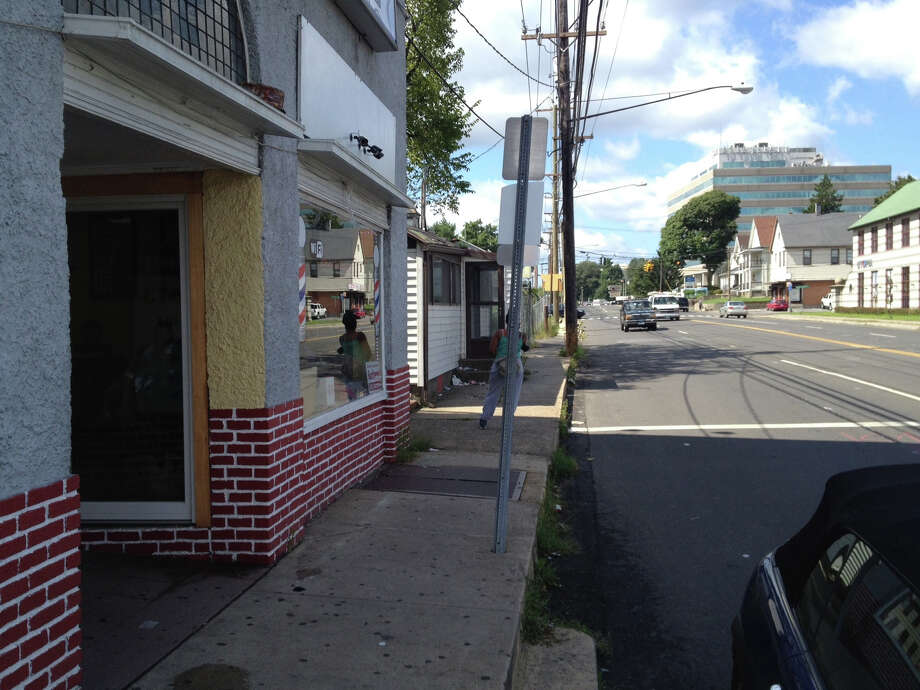 An unidentified man was stabbed Monday, Aug. 27, 2012 while waiting for a bus outside Zack Barber Shop on Connecticut Avenue in Norwalk, Conn., police said. Photo: John Nickerson