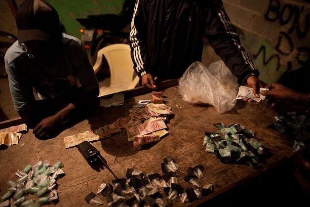 In Rio's Antares slum, piles of money and packages of marijuana and cocaine are out in the open. Photo: Felipe Dana, Associated Press