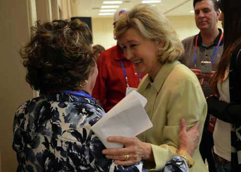 Sen. Kay Bailey Hutchison, R-Texas, talks with supporters at the RNC. (Jennifer A. Dlouhy / Houston Chronicle)   (Jennifer A. Dlouhy / Houston Chronicle)