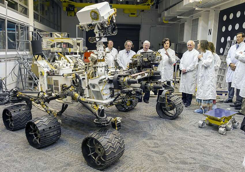 U.S. Sen. Dianne Feinstein, D-Calif. (center), tours a Curiosity double in Pasadena on Aug. 23.