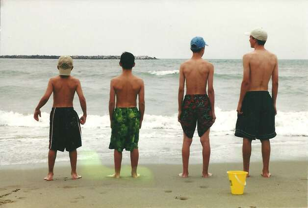 These photo is of our 4 sons--Cris, Brandon, Matthew and Cameron Fischer taken in 2002 on the California coast during a family trip. Sometime before the trip we came across a similar photo taken 10 years earlier on the coast of England and thought it would be a cool idea to get another updated shot.  We're hoping to get another pic this year, now 10 years after the second photo. -- James Fischer Photo: Then & Now (Fischer)