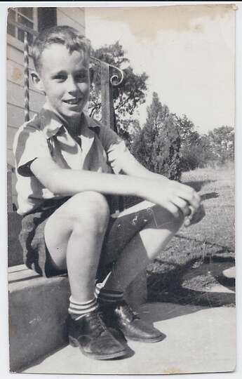 This photo is a picture of my Dad, Larry Bower, taken in 1942 at 8 years of age in front of his hous