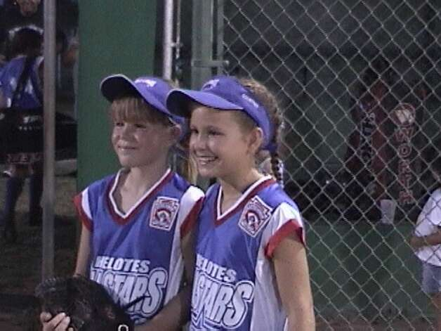 Best friends Brittany Stone (left) and Courtney Tietze, both 10, were softball teammates at the 2003 Helotes All-Star Tournament. Photo: Then & Now (Stone)
