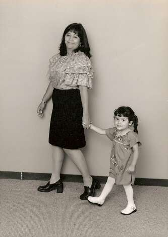 In 2000, Patty Constantin and her daughter Julianna Burris, 3, were photographed at the Institute of Texas Cultures for a mural that was included in an exhibit featuring a collection of shoes worn by famous Texans.  I worked at the Institute at the time and they sort of walked through the office asking for volunteers,  she recalls. She got a copy of the photo and, when the exhibit was dismantled, the four-foot long mural as well. Photo: Patty Constantin, Reader Submiss
