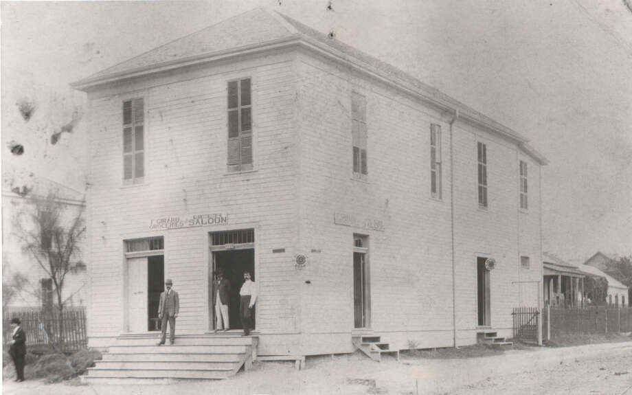 Then:This photo, circa 1890, shows the two story Girard Grocery and Beer Saloon  located at 301 N. San Saba. -- Joe V. Girard Photo: Joe Girard, Reader Submission