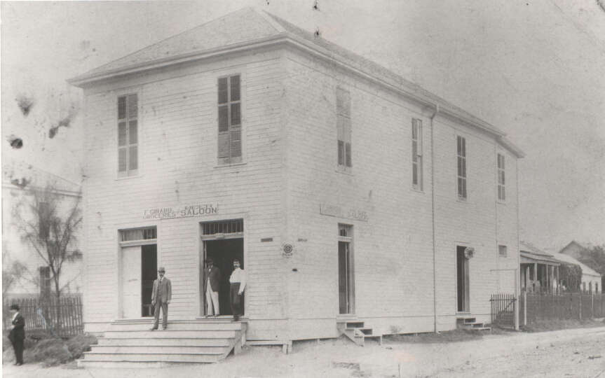 This photo, circa 1890, shows the two story Girard Grocery and Beer Saloon  located at 301 N. San Sa