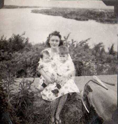 With the Missouri River in the background, Susan Oswald James and her older brother Gregory S. Oswald sit in the lap of their mother Velma S. Oswald. The photo was taken in 1947 in Harley Park in Boonville, Mo. Photo: Susan James, Reader Submission