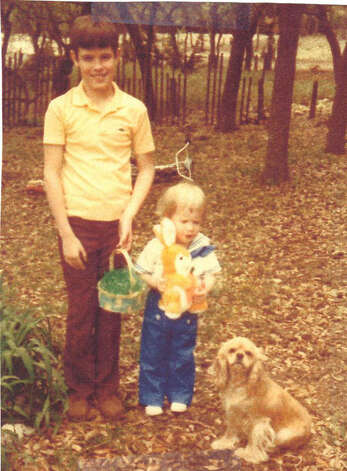 It was Easter 1982 when the Scott brothers, John, 10 and Jeffrey, 2, posed in their Bandera backyard alongside their cocker spaniel Taffy.  We were about to take the picture when Taffy came over and sat right down, like she wanted to be in it, too,  says the boys  mother Lo-Rena. The framed photo has been in the family living room ever since. Photo: Lo-Rena Scott, Reader Submission