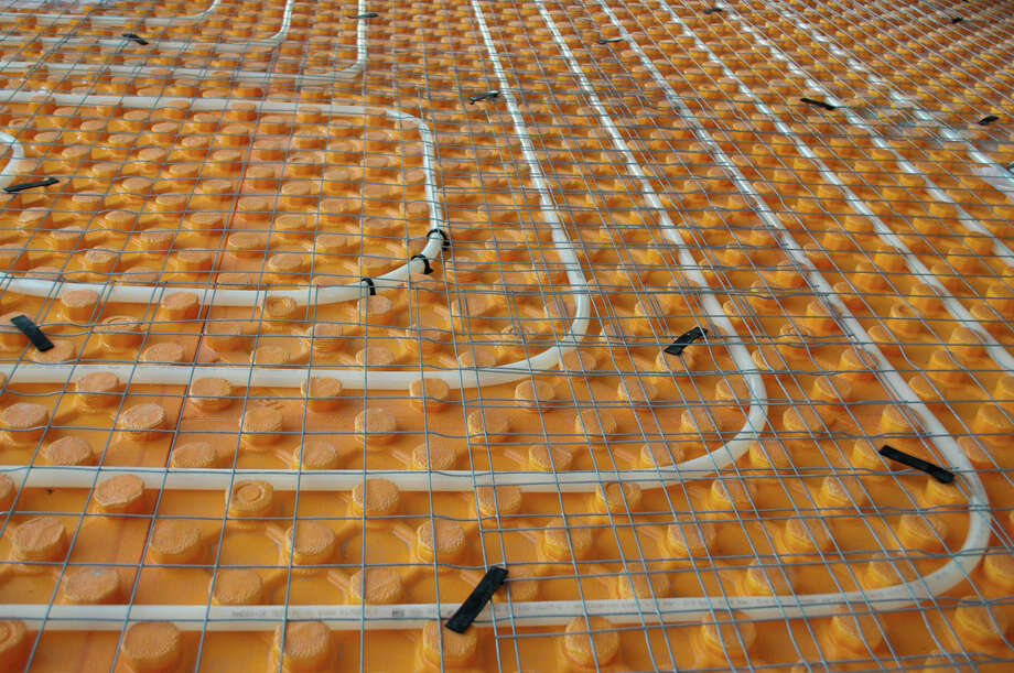 According to the U.S. Department of Energy, radiant underfloor heating is more efficient than baseboard or forced-air heating and can run off of a variety of energy sources. It is also a good choice for those with allergies as no potentially irritating particles get blown around the room. The photo above shows an installation in progress. Photo courtesy of  Zoonar/Thinkstock Photo: Contributed Photo