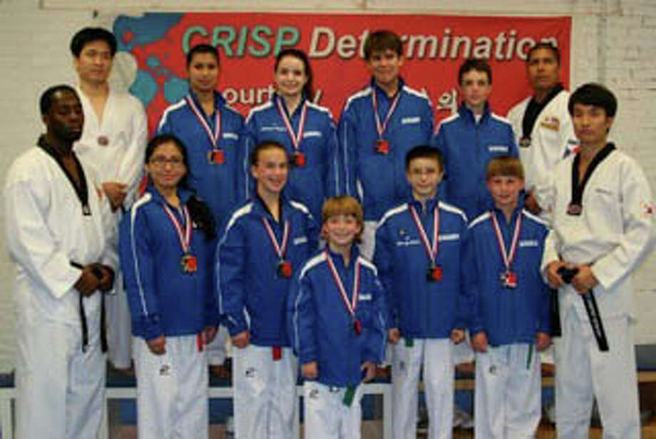 Twelve members of World Championship Taekwondo in Fairfield earned medals at the National Championships June 29- July 4 in Dallas. Members are, front row, from left, Instructor Shawn Kennedy, Karol Pena, Daisy Johnson,Clayton Johnson, Kenny Hine, Brian Meagher, Master Kwangjin ha; back row, from left, Jaeho Song, Kiran Bomma, Mariana Mangini, Kevin Coronel, Mathieu Freeman, (missing: MarkAnthony Garcia, Maddie Lesko, and Aven Williams) Photo: Contributed Photo