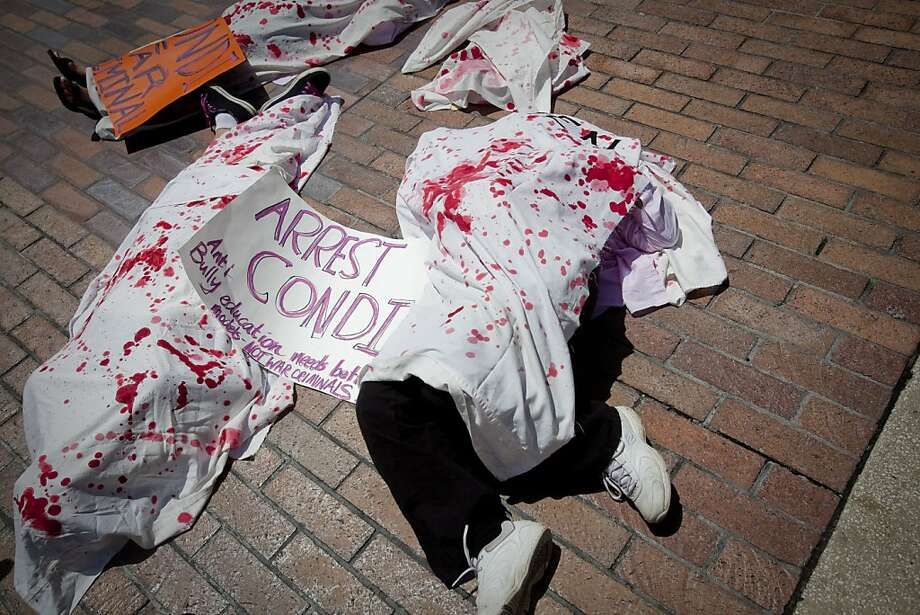 TAMPA, FL - AUGUST 28:   Several protesters from Code Pink lay under sheets to bring attention to the casualties of foreign conflicts outside the Straz Center for the Performing Arts during the National Republican Convention on August 28, 2012 in downtown Tampa, Florida. The Code Pink protesters were on hand to perform a citizen's arrest on Former Secretary of State Condoleezza Rice for her involvement in the U.S. lead wars in Afghanistan and Iraq. Photo: Edward Linsmier, Getty Images