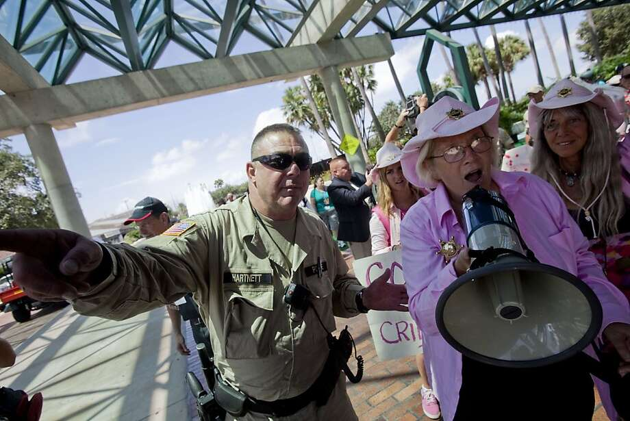 TAMPA, FL - AUGUST 28:   Protesters from Code Pink are escorted by law enforcement officials from the Straz Center for the Performing Arts during the National Republican Convention on August 28, 2012 in downtown Tampa, Florida. The Code Pink protesters were on hand to perform a citizen's arrest on Former Secretary of State Condoleezza Rice for her involvement in the U.S. lead wars in Afghanistan and Iraq. Photo: Edward Linsmier, Getty Images