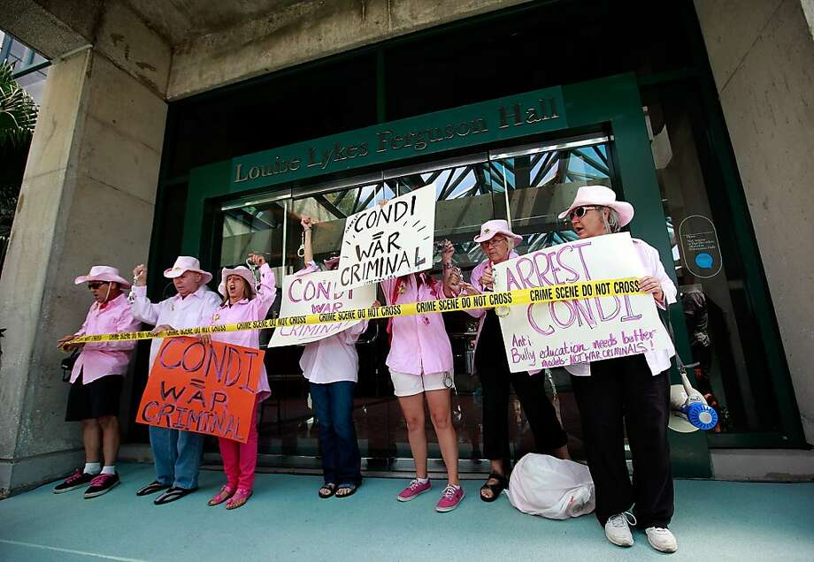 TAMPA, FL - AUGUST 28:  Code Pink protesters demonstrate in front of the Stratz Center for the Performing Arts on August 28, 2012 in Tampa, Florida. The Code Pink protesters were on hand to perform a citizen's arrest on Former Secretary of State Condoleezza Rice for her involvement in the U.S. lead wars in Afghanistan and Iraq. Photo: Tom Pennington, Getty Images