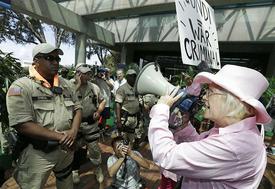 A Code Pink demonstrator chants at a venue where former Secretary of State Condoleezza Rice was to speak, Tuesday, Aug. 28, 2012, in Tampa, Fla. Protestors gathered in Tampa to march in demonstration against the Republican National Convention. Photo: Chris O'Meara, Associated Press