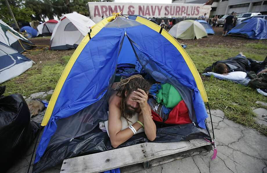 "A demonstrator prepares to leave his tent, Tuesday, Aug. 28, 2012, in Tampa, Fla. Protestors gathered in a camp called ""Romneyville,"" in Tampa to march in demonstration against the Republican National Convention. Photo: Dave Martin, Associated Press"