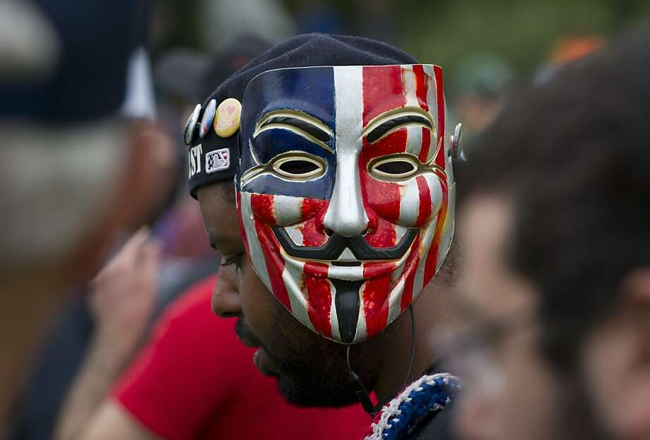 An anti-GOP protester wears a Guy Fawkes mask, symbol of the occupy movement, during a protest rally in downtown Tampa , Florida August 27, 2012. Due to incoming severe weather and possible hurricane conditions expected to hit the state by Monday, the Republicans have decided to cut short their National Convention by one day. Photo: Mladen Antonov, AFP/Getty Images