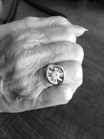 "Anne Semmes displays her not-quite-diamond-anymore ring. It was a family heirloom on which she commited ""assault and battery."" Photo: Contributed Photo"