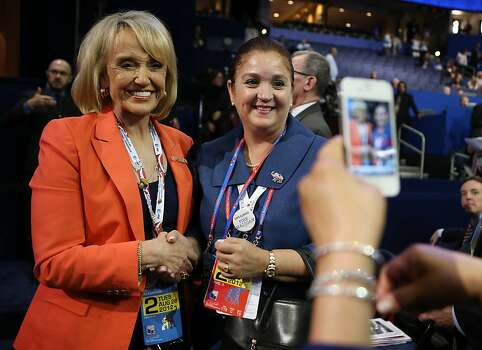 TAMPA, FL - AUGUST 28: Arizona Gov. Jan Brewer (L) poses with a delegate during the Republican National Convention at the Tampa Bay Times Forum on August 28, 2012 in Tampa, Florida. Today is the first full session of the RNC after the start was delayed due to Tropical Storm Isaac. Photo: Chip Somodevilla, Getty Images