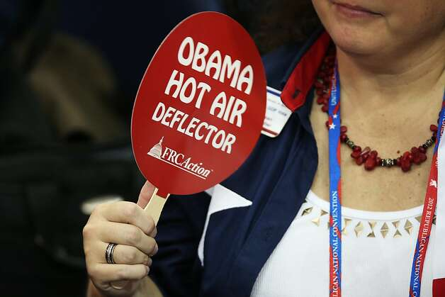 "TAMPA, FL - AUGUST 28: A woman uses a fan that reads ""Obama Hot Air Deflector"" during the Republican National Convention at the Tampa Bay Times Forum on August 28, 2012 in Tampa, Florida. Today is the first full session of the RNC after the start was delayed due to Tropical Storm Isaac. Photo: Win McNamee, Getty Images"