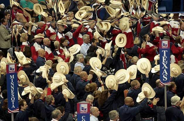 Delegates from Texas raise their hats at the Republican National Convention (RNC) in Tampa, Florida, U.S., on Tuesday, Aug. 28, 2012. Delegates are gathered in Tampa at the 40th Republican National Convention to select former Massachusetts governor Mitt Romney as their nominee for the next president of the United States. Photo: Andrew Harrer, Bloomberg