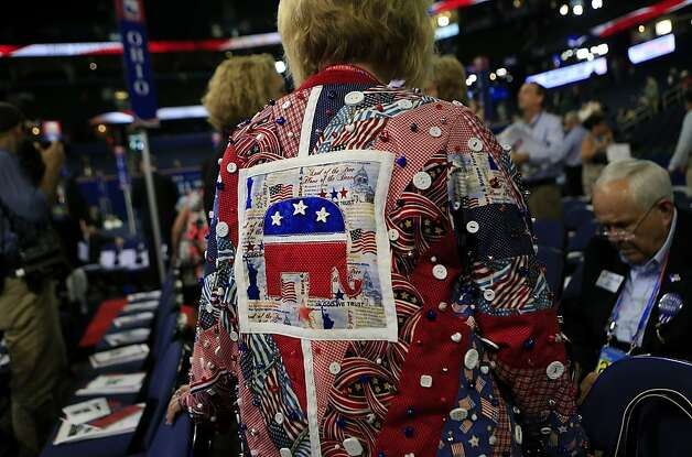 A delegate wears a quilt jacket at the Republican National Convention (RNC) in Tampa, Florida, U.S., on Tuesday, Aug. 28, 2012. Delegates are gathered in Tampa at the 40th Republican National Convention to select former Massachusetts governor Mitt Romney as their nominee for the next president of the United States. Photo: Andrew Harrer, Bloomberg