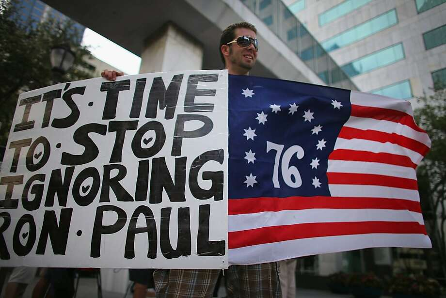 TAMPA, FL - AUGUST 28: Will Greig shows his support for former Republican presidential candidate U.S. Rep. Ron Paul (R-TX) as he protests on the first full day of the Republican National Convention at the Tampa Bay Times Forum on August 28, 2012 in Tampa, Florida. The Republican party delegates were prepared to affirm Mitt Romney as the party's nominee as the convention began its first full session after the start was delayed due to Tropical Storm Isaac. Photo: Joe Raedle, Getty Images