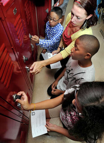 Sixth-graders get some adult help figuring out their locker combinations at ...